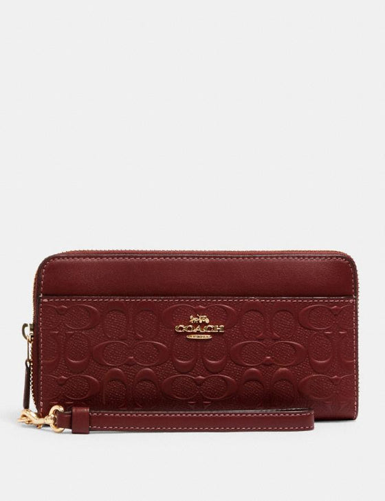 Coach Accordion Zip Wallet With Wristlet Strap In Signature Debossed Wine