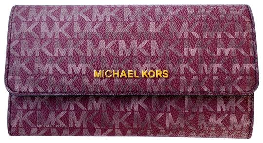 Michael Kors Large Trifold Purse In Monogram Oxblood