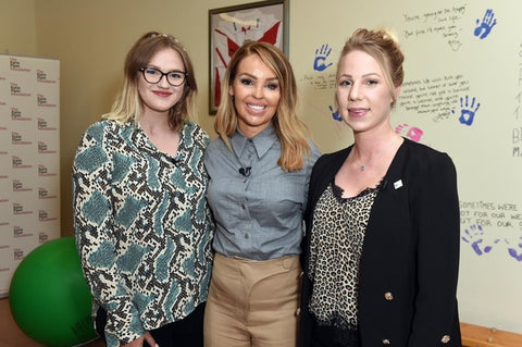 katie piper with charity team members
