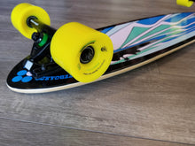 "Closeup of Black Angel 40"" Pintail Longboard with yellow Bustin Premier Formula wheels"