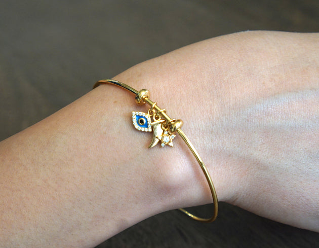 Bangle with Evil Eye, Star and Claw Charms