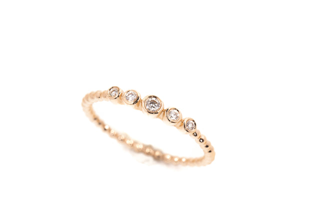 14k Gold Dot Band with 5 Graduated Bezel Set Diamonds Across The Top
