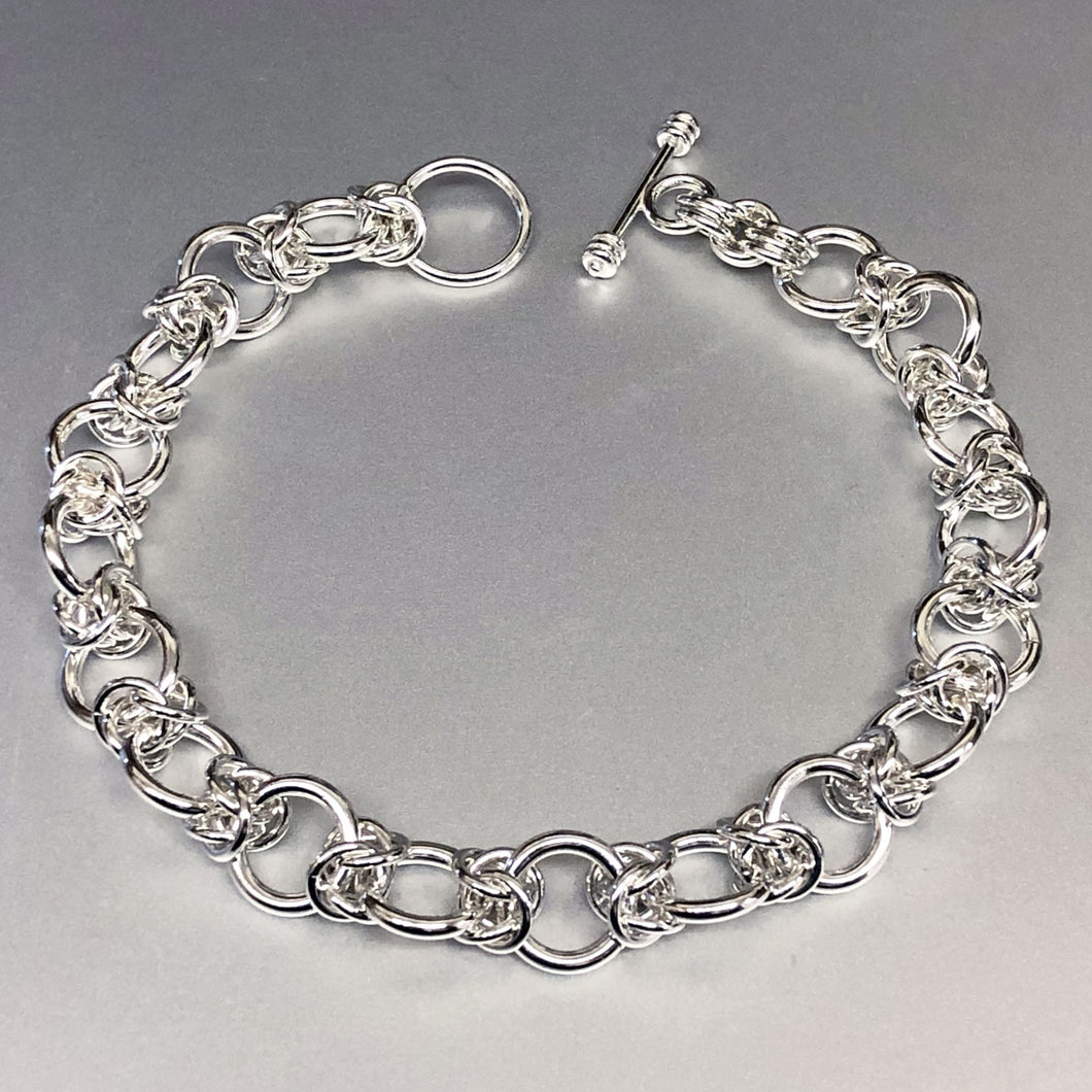 The Seaxwolf Colleen is our unique fine handcrafted sterling silver Byzantine III bracelet design variation.
