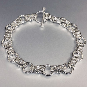 The Seaxwolf Collette is  handcrafted from solid sterling silver Byzantine III bracelet unique variation.