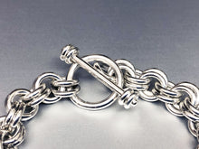 Closeup of Seaxwolf handcrafted extra chunky sterling silver 12 gauge double link bracelet with designer clasp for men and women.