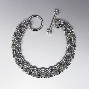 Seaxwolf handcrafted super chunky sterling silver 12 gauge double link bracelet with designer clasp for men and women.