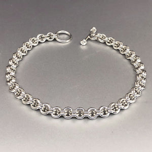 Seaxwolf handmade solid sterling silver double link thin bracelet for men and women.