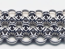 Closer look at seaXwolf handmade fine jewelry signature HexaFleur, solid sterling silver chain mail bracelet based on sacred geometry of the hexagon flower.