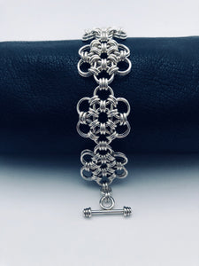 seaXwolf handmade fine jewelry signature HexaFleur Daisy Chain, solid sterling silver chain mail bracelet based on sacred geometry of the hexagon flower.
