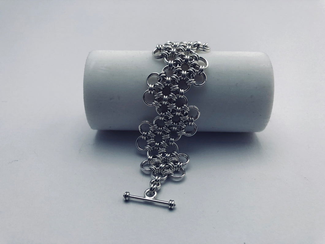 seaXwolf handmade fine jewelry signature HexaFleur Undulating, solid sterling silver chain mail bracelet based on sacred geometry of the hexagon flower.