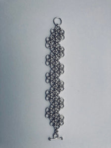 seaXwolf handmade fine jewelry chunky HexaFleur Undulating Serpentine, solid 925 sterling silver chain mail bracelet based on sacred geometry of the hexagon flower.