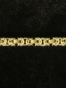 Closeup on design of brass Byzantine 3 bracelet handmade by seaXwolf Fine Jewelry