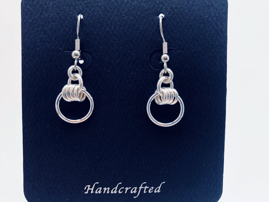 Seaxwolf handcrafted sterling silver small wave dangle earrings.