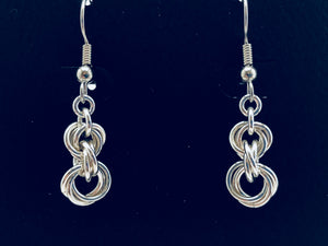 "seaXwolf fine handmade jewelry solid sterling silver chain earrings entitled ""Twisted Roses"" because they look like a tiny voluptuous bouquet of budding roses."