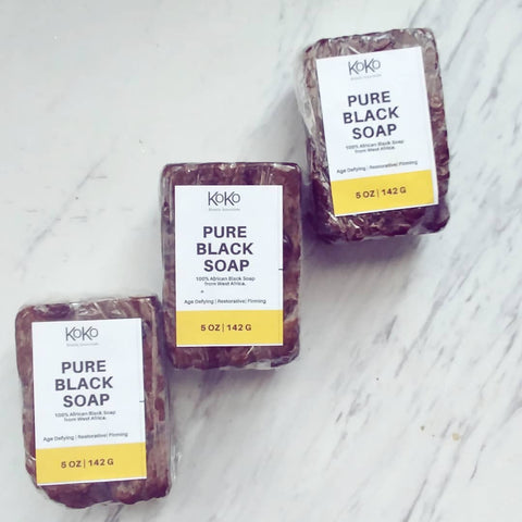 three african black soap bars lined up vertically