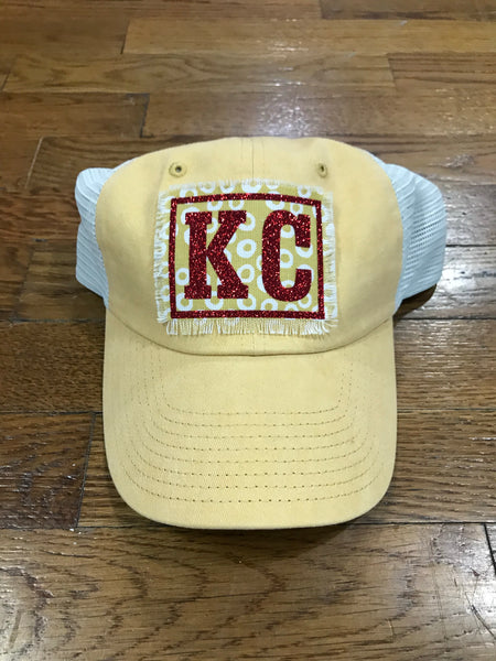 Yellow with red KC hat