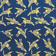 GIFTSLAND-WRAP-SWALLOWS GOLD ON BLUE