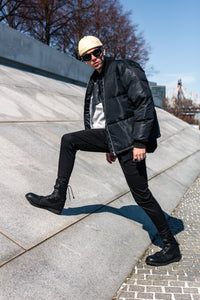 Products shown: Meridian Cap, Nova Sunglasses, AW19 Puffy Coat, Nano-Wing Slacks. MODEL: Anthony Flora PHOTOGRAPHER: Gerome Ventura