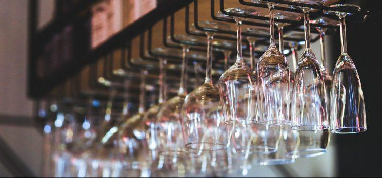 Wine glasses hanging from a shelf