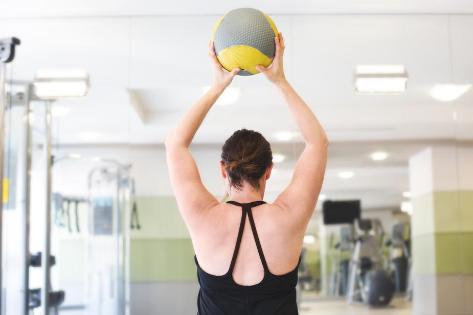 Exercising in the gym with a stressball