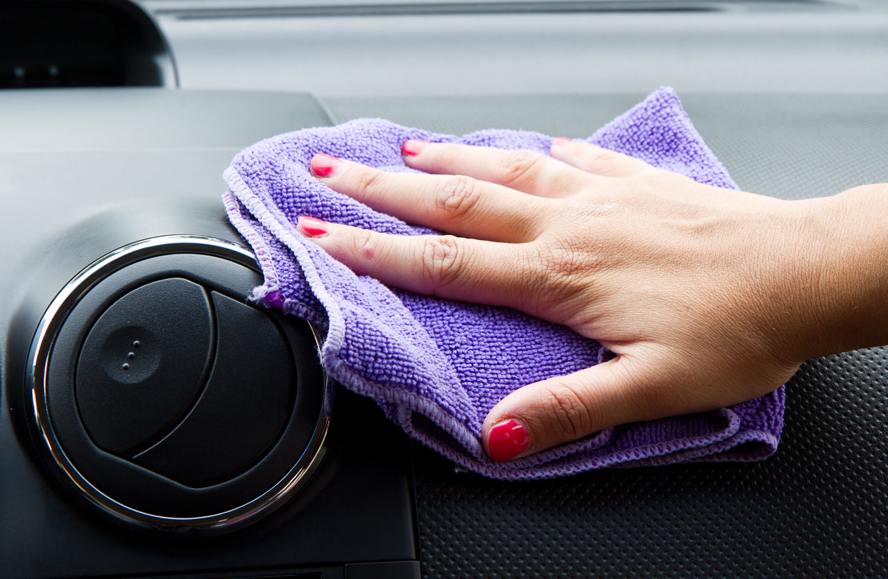 clean car regularly to reduce smell