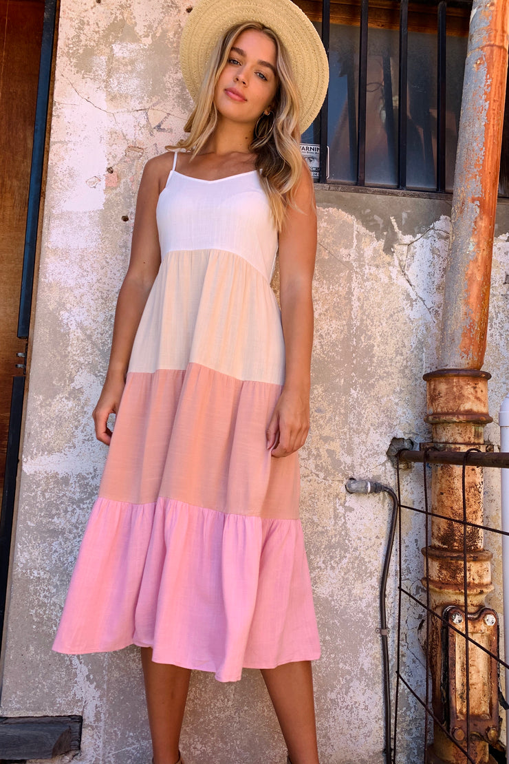 Halo and Hutch linen dress in white, pink, and nude.