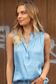 Macy | Low Collared Asymmetric Hem Blouse in Sky Blue