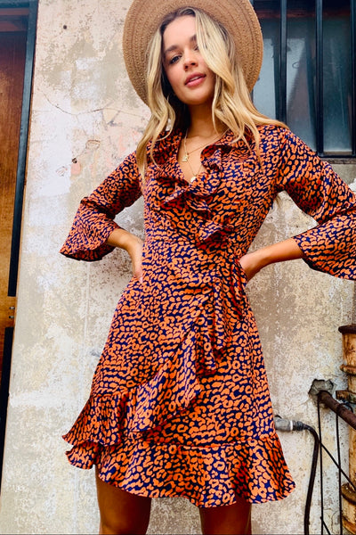 Tia | Dress In Orange And Navy Animal Print (New Arrival)