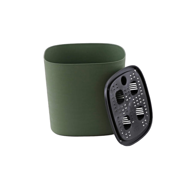 green plastic self-watering plant pot