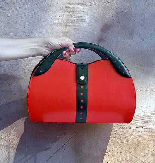 Red and black top handle bag by Steven Harkin