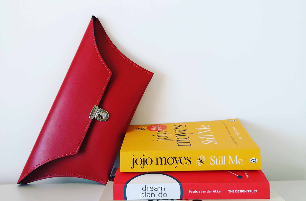 Award winning clutch bag in red leather