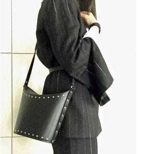 black bucket bag with shoulder strap