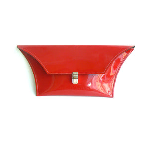 red patent leather clutch bag