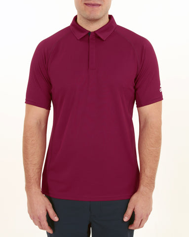 Man wearing maroon Adidas recycled bermuda polo