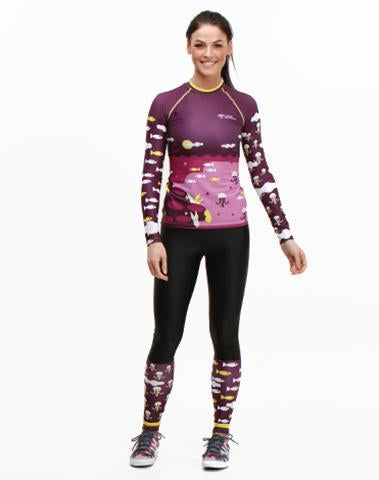 Woman wearing Trashee collection Rashguard and Leggings made from Recycled Ocean Waste
