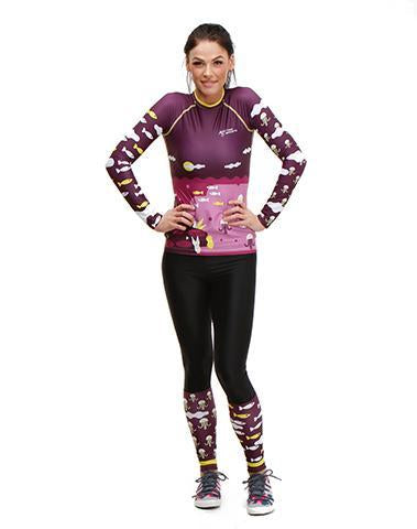 Fit women wearing Trio Sports Recycled Polyester Trashee Rashguard and Leggings made from Recycled Ocean Waste