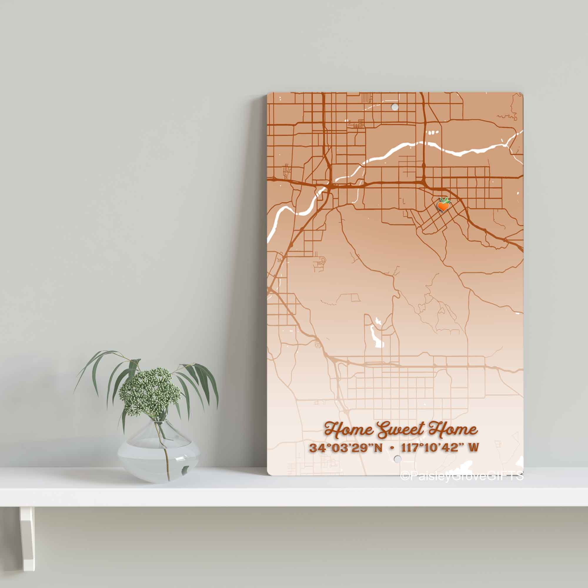 S902g-Copyright PaisleyGroveGIFTS-Redlands Map Hometown Metal Sign Home Sweet Home with Coordinates 8x12 inch metal sitting on shelf