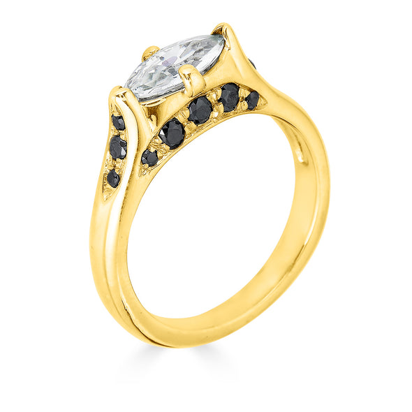 Center diamond and yellow gold ring with black diamond pave