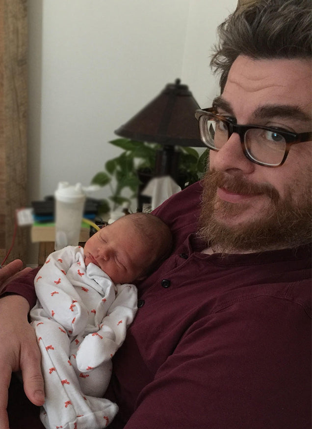 Father holding baby after IVF treatment birth