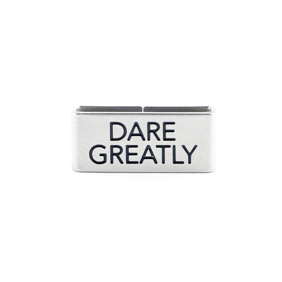 Our Dare Greatly Collectible Tag symbolizes the mindset to choose Courage Over Comfort, Ambition, and Focus.