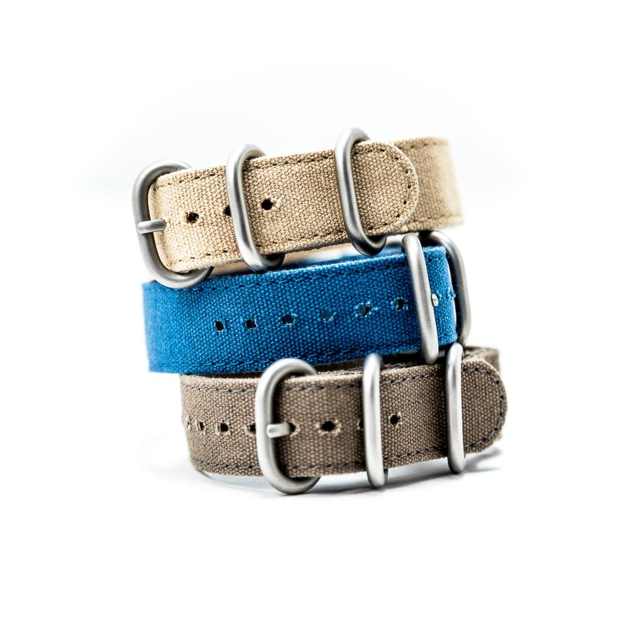 The rugged cotton canvas bracelet is inspired by vintage military issue straps and uniforms.