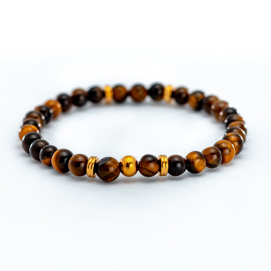 Tiger Eye Stone Bead Bracelethelps you to release fear and anxiety and aids harmony and balance.