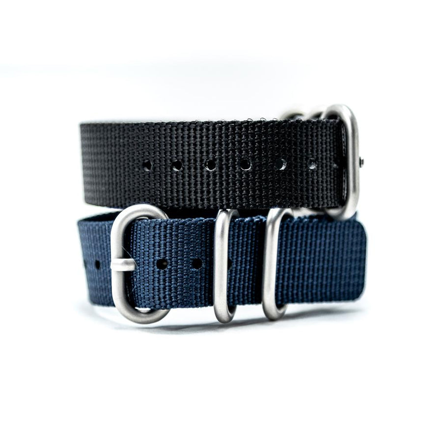 The heavy weave nylon bracelet is both light weight and sturdy. Waterproof. Sweat proof. Gym friendly. Full rad factor.