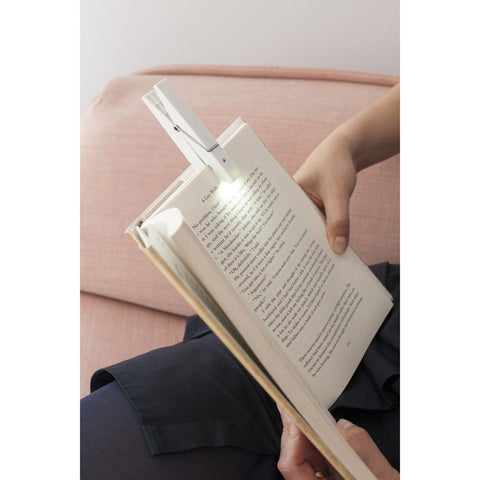 peg shaped reading light clipped on to book