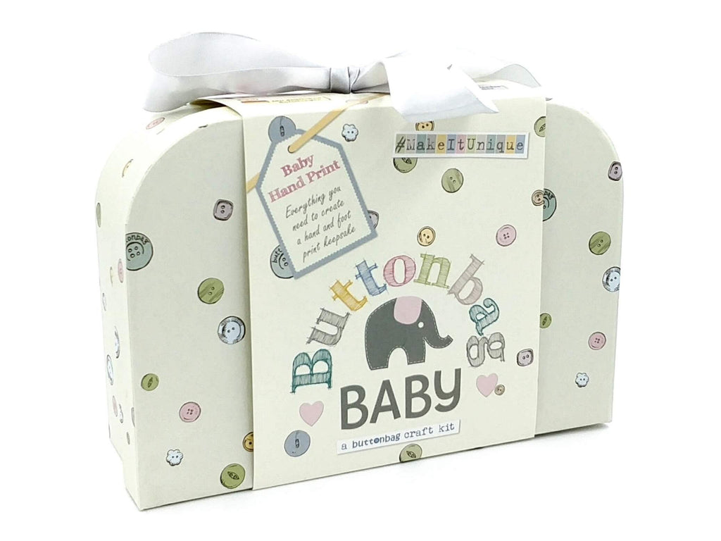 gender neutral baby handprint kit in mini cream suitcase with a ribbon, front view