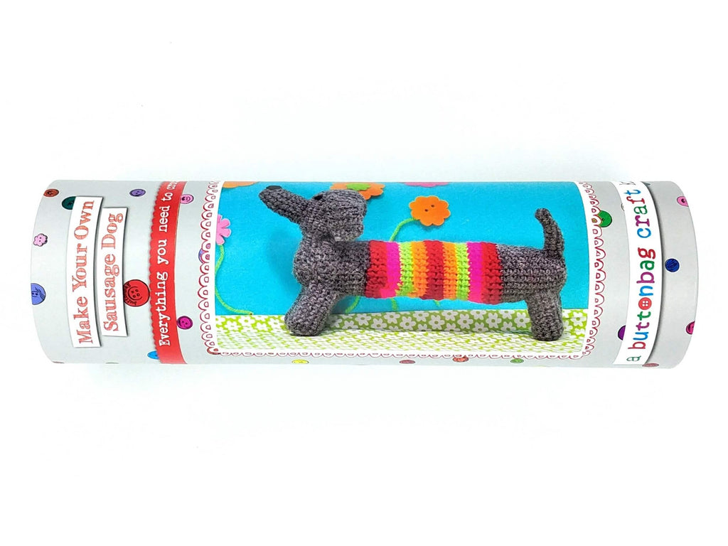 crochet your own sausage dog gender neutral kit in grey tube with buttons as polka dots