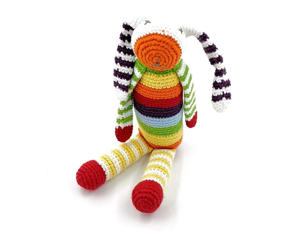 crochet rabbit gender neutral soft toy with multicoloured stripes sitting up