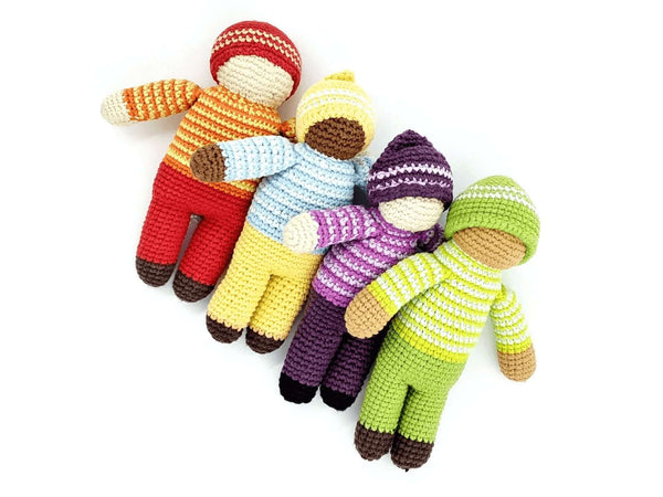 four soft crochet gender neutral dolls in various colour outfits with different skin colours