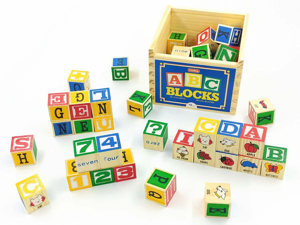 Colourful wooden gender neutral alphabet building blocks scattered around