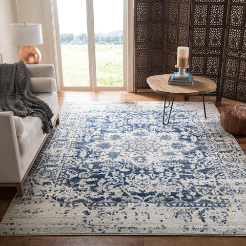 Safavieh Madison Collection Cream and Navy Distressed Medallion Area Rug (4' x 6')